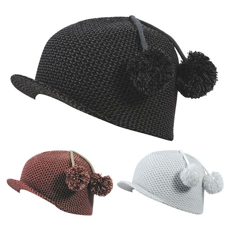 Bonnet en tricot jacquard entrecroisé avec bord doux et pompon